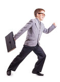 Running Boy in a suit isolated on the white Royalty Free Stock Photos