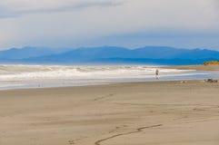 Running boy at Sunset in Hokitika, New Zealand Royalty Free Stock Photos