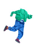 Running boy.White background on which clothes are laid out in th Stock Photos