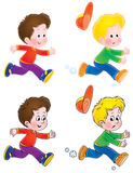 Running boys playing tag Stock Images