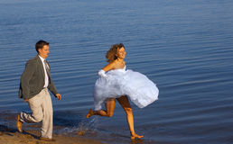 Running bride and fiance Royalty Free Stock Images