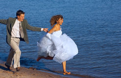 Running bride and fiance Royalty Free Stock Image