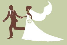 Running bride and groom. In profile Stock Photos