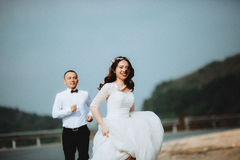 Running bride and groom Royalty Free Stock Photo