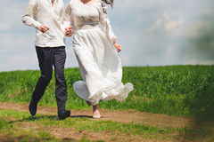 Running Bride and Groom Stock Photography