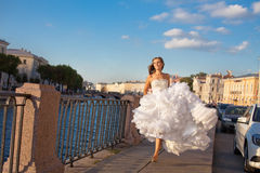 Running bride outdoor Royalty Free Stock Photos
