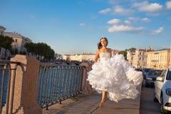 Running bride outdoor Royalty Free Stock Photos
