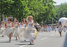 Running Brides during the traditional Street Race in Belgrade Royalty Free Stock Image