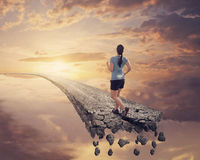 Running on broken road. Royalty Free Stock Images
