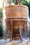 Running Brown Water Fountain. Fountain with water spraying from it Royalty Free Stock Photo