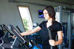 Running brunette in black t-shirt at gym Stock Photos