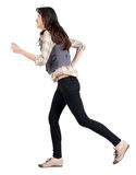 Running brunette girl back view Royalty Free Stock Photography