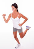 Running brunette woman on white background Royalty Free Stock Image
