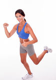Running brunette woman on white background Stock Images