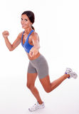 Running brunette woman on white background Royalty Free Stock Images