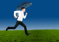 Running business man. Young business man running in the filed Stock Photography
