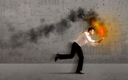 Running business man with fire laptop Stock Images