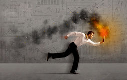 Running business man with fire laptop. Running business man in a hurry with fire laptop concept Royalty Free Stock Photos
