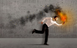Running business man with fire laptop Royalty Free Stock Images
