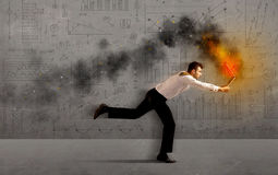Running business man with fire laptop Royalty Free Stock Photography