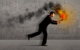 Running business man with fire laptop Royalty Free Stock Photos