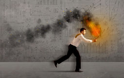 Running business man with fire laptop. Running business man in a hurry with fire laptop concept Royalty Free Stock Images