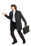 Running a business man in a raincoat Stock Image
