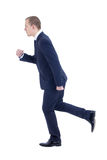 Running business man in suit isolated on white. Background Royalty Free Stock Photos