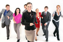 Running business people folow a leader Stock Images