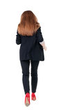 Running business woman. back view. going young girl in  suit. Re Stock Image