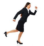 Running business woman. Business woman running fast smiling cheerful. Isolated on white background Stock Image