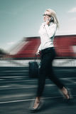 Running business woman. Business woman running on track on stadium. Motion blur