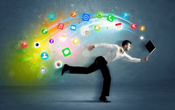 Running businessman with application icons from device Royalty Free Stock Photo