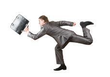 Running businessman with briefcase Royalty Free Stock Images