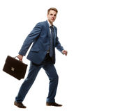 Running businessman with briefcase Royalty Free Stock Photos