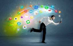 Running businessman with application icons from device Stock Photos