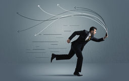 Running businessman with device and hand drawn lines Stock Photos
