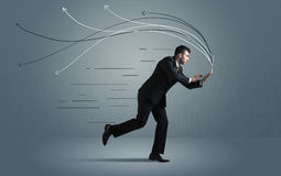 Running businessman with device and hand drawn lines Royalty Free Stock Photos