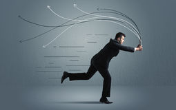 Running businessman with device and hand drawn lines Royalty Free Stock Photo