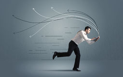 Running businessman with device and hand drawn lines Royalty Free Stock Image