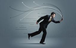 Running businessman with device and hand drawn lines Stock Photo
