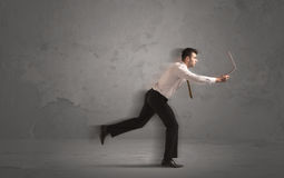 Running businessman with device in hand Stock Image