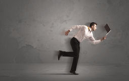 Running businessman with device in hand Stock Images