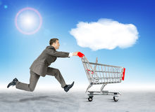 Running businessman with empty shopping cart Stock Photos