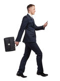 Running businessman with his briefcase and mobile phone on white Stock Photography