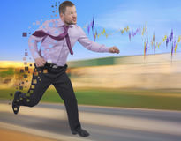 Running businessman in a hurry on blurred background Stock Image