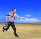 Running businessman in a hurry on blurred Royalty Free Stock Photo