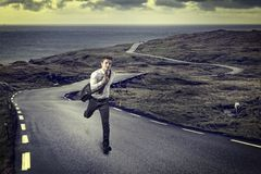 Man run on lonely road stock photos