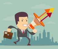 Running businessman with a megaphone Stock Image