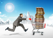 Running businessman with shopping cart Stock Images